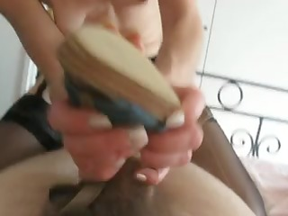 husband receives a hot shoe job by wife and gives