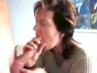 older mom sucking & swallowing goo