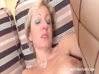 aged blond bitch masturbates with sextoy