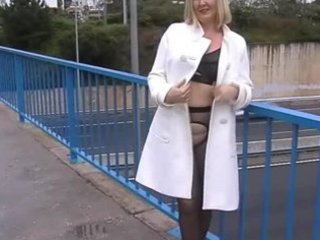 wife in darksome tights hose flashing on a busy