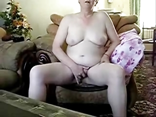 aged lady completely in nature masturbating