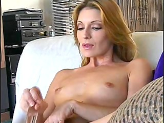 glamorous mature cougar masturbates with dildo