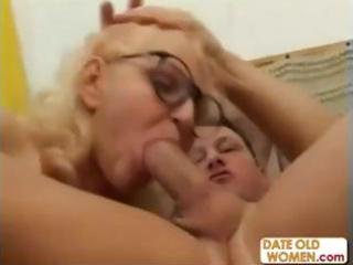 golden-haired grandmother throats a younger jock