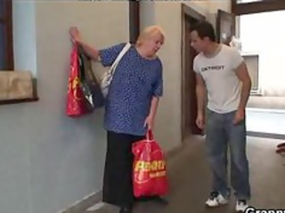 excited young guy bangs old blonde woman aged