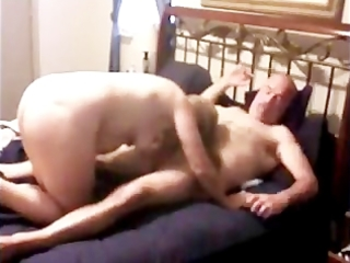 mature couple copulates with a cockring
