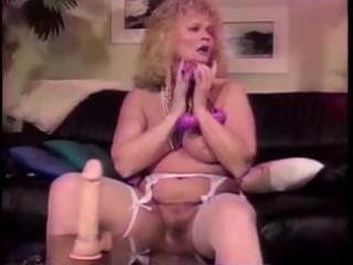 busty older blond shablee plays with toys in both
