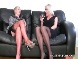 golden-haired lesbian rubs her older pussy
