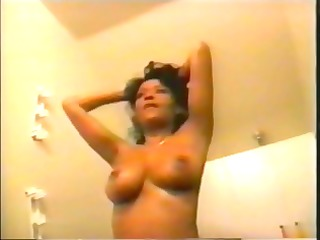breasty ebon jeannie in a 83s clip showing her