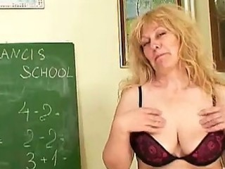 older golden-haired teacher with huge tits