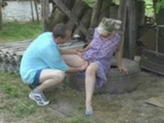 granny copulates anal in the garden with the