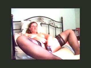 uk floozy fucking her self with a massive dildo